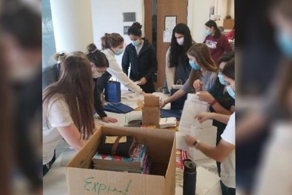 Dental students assembling activity bags