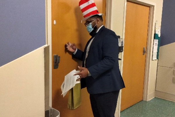 Kevin Rountree practicing AIDET while distributing Read-A-Thon materials.